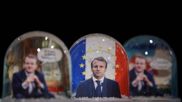 Snowglobes depicting French President Emmanuel Macron, made by Bruot company in eastern France, are displayed at a store in Paris, France, November 17, 2017. REUTERS/Christian Hartmann