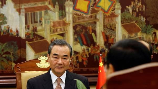 FILE PHOTO - China's Foreign Minister Wang Yi (L) attends a meeting with Vietnam's Deputy Prime Minister and Foreign Minister Pham Binh Minh at the Government Office in Hanoi, Vietnam November 2, 2017. REUTERS/Kham