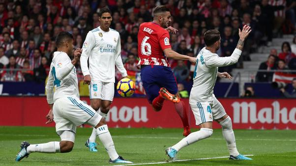Barcelona hailed real winners of bruising Madrid derby