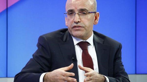 محمد شيمشك نائب رئيس الوزراء التركي في دافوس يوم 19 يناير كانون الثاني 2017 - رويترز