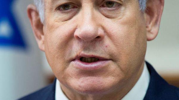 FILE PHOTO - Israeli Prime Minister Benjamin Netanyahu chairs the weekly cabinet meeting at his office in Jerusalem November 7, 2017. REUTERS/Ariel Schalit/Pool