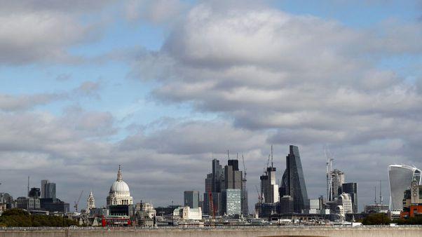 Buildings in the City of London are seen behind Waterloo Bridge in London, Britain October 20, 2017. Picture taken October 20, 2017. REUTERS/Peter Nicholls