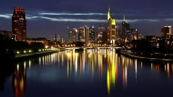 The skyline, with its characteristic banking towers, is reflected in river Main in Frankfurt, Germany, October 1, 2017.  REUTERS/Kai Pfaffenbach