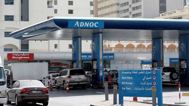FILE PHOTO: Cars are seen an ADNOC petrol station in Abu Dhabi, United Arab Emirates July 10, 2017. REUTERS/Stringer/File Photo