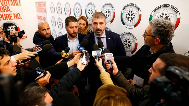 Vice president of the CasaPound party Simone Di Stefano talks with reporters during a news conference in their headquarters in Rome, Italy November 9, 2017. REUTERS/Tony Gentile