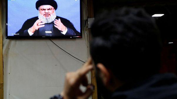 A man watches Lebanon's Hezbollah leader Sayyed Hassan Nasrallah as he speaks on television in Beirut, Lebanon November 20, 2017.REUTERS/ Jamal Saidi