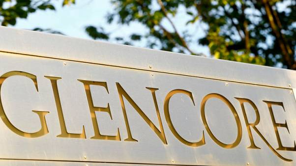 FILE PHOTO - The logo of commodities trader Glencore is pictured in front of the company's headquarters in Baar, Switzerland, July 18, 2017.  REUTERS/Arnd Wiegmann/File Photo