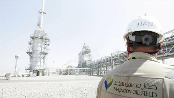 A worker walks through the  Majnoon oilfield in Basra, 420 km (261 miles) southeast of Baghdad, October 6, 2013.  REUTERS/Essam Al-Sudani