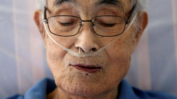 """Katsuo Saito, 89, who has leukaemia, uses an oxygen tube as he rests at his house in Tokyo, Japan, September 8, 2017. REUTERS/Kim Kyung-Hoon  SEARCH """"JAPAN DYING"""" FOR THIS STORY. SEARCH """"WIDER IMAGE"""" FOR ALL STORIES.  TPX IMAGES OF THE DAY."""