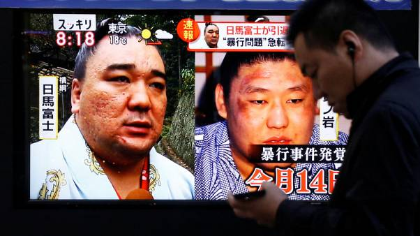 Sumo - Grand champion Harumafuji retires over assault incident