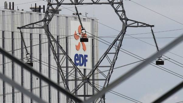 Electrical power pylons of high-tension electricity power lines are seen next to the EDF power plant in Bouchain, near Valenciennes, July 29, 2013.  REUTERS/Pascal Rossignol )
