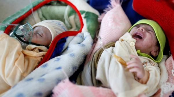 Malnourished twin brothers Muhammad (L) and Ahmad Abdulraouf, who are one-and-a-half-month-old, lie on a bed at the al-Sabeen hospital in Sanaa, Yemen, April 13, 2017. REUTERS/Khaled Abdullah