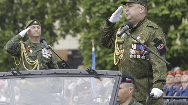 FILE PHOTO: Igor Plotnitsky (R), leader of the self-proclaimed Lugansk People's Republic, salutes during the Victory Day military parade in the rebel-held city of Luhansk, Ukraine May 9, 2017. REUTERS/Alexander Ermochenko/File Photo