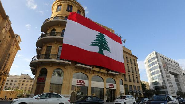 A Lebanese flag hangs from a building in downtown Beirut, Lebanon, November 21, 2017. REUTERS/Aziz Taher