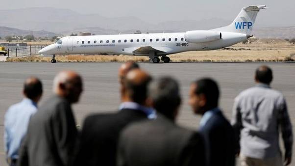 Officials from the Houthi-led government wait as a plane carrying the U.N. Under-Secretary-General for Humanitarian Affairs Mark Lowcock taxis at Sanaa airport, Yemen, October 25, 2017. REUTERS/Khaled Abdullah