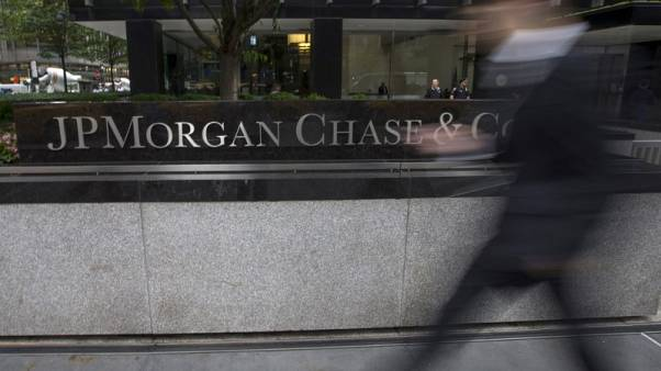 FILE PHOTO: People pass the JP Morgan Chase & Co. Corporate headquarters in the Manhattan borough of New York City, May 20, 2015. REUTERS/Mike Segar/File Photo