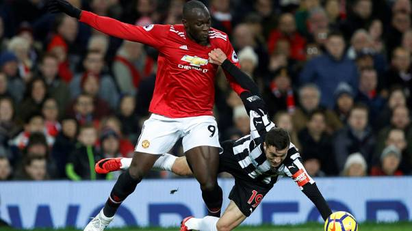 Soccer Football - Premier League - Manchester United vs Newcastle United - Old Trafford, Manchester, Britain - November 18, 2017   Manchester United's Romelu Lukaku in action with Newcastle United's Javi Manquillo    Action Images via Reuters/Carl Recine