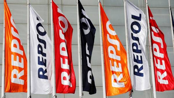 FILE PHOTO: Repsol flags are seen at a conference hall during the company's annual shareholders meeting in Madrid, Spain, May 19, 2017.  REUTERS/Paul Hanna/File Photo