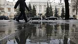 FILE PHOTO: A man walks near the Central Bank headquarters in central Moscow, Russia January 29, 2016. REUTERS/Maxim Zmeyev/File Photo