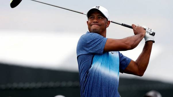 FILE PHOTO - Aug 13, 2015; Sheboygan, WI, USA; Tiger Woods hits his tee shot on the 11th hole during the first round of the 2015 PGA Championship golf tournament at Whistling Straits. Mandatory Credit: Brian Spurlock-USA TODAY Sports