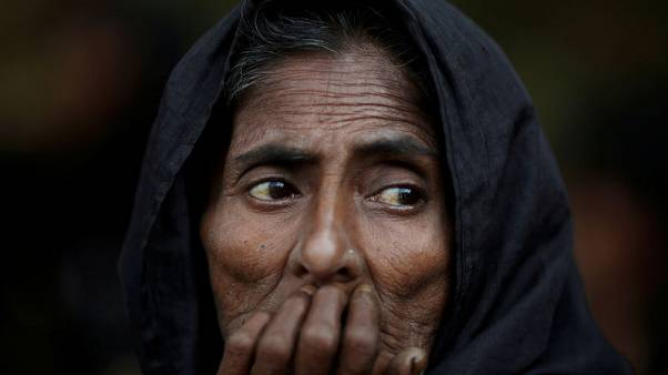 Noor Mohol, 60, a Rohingya refugee waits to get herself registered for humanitarian aid at the Kutupalong refugee camp near Cox's Bazar, Bangladesh October 23, 2017. REUTERS/Adnan Abidi