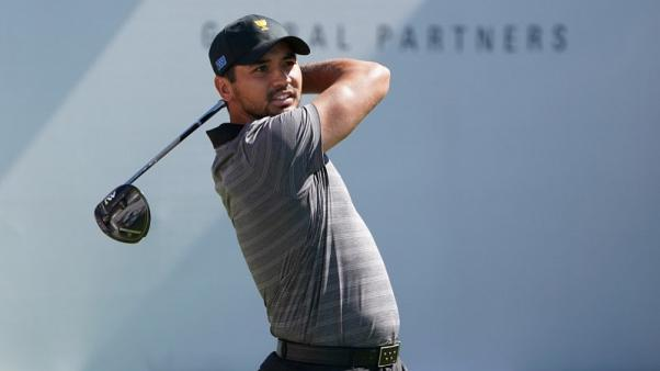 FILE PHOTO: Oct 1, 2017; Jersey City, NJ, USA; Jason Day tees off on the first hole during the final round singles matches of The President's Cup golf tournament at Liberty National Golf Course. Kyle Terada-USA TODAY Sports