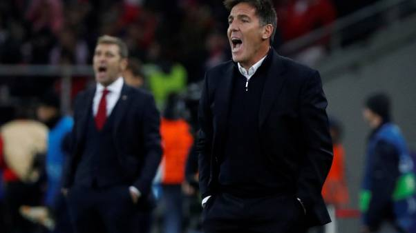 FILE PHOTO - Soccer Football - Champions League - Spartak Moscow vs Sevilla - Otkrytiye Arena, Moscow, Russia - October 17, 2017   Sevilla coach Eduardo Berizzo (R) and Spartak Moscow coach Massimo Carrera (L) react   REUTERS/Grigory Dukor