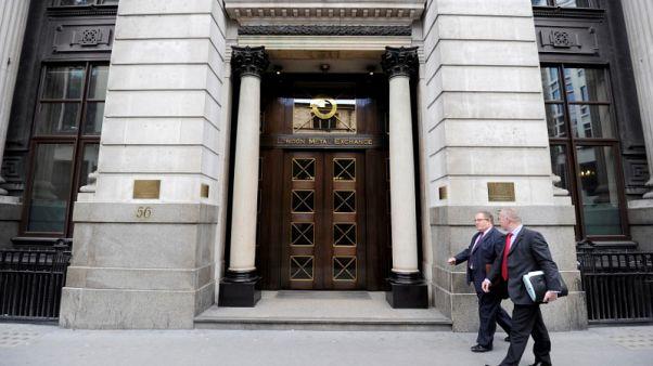 Men walk past the London Metal Exchange (LME) in London, July 22, 2011.      REUTERS/Paul Hackett/File Photo