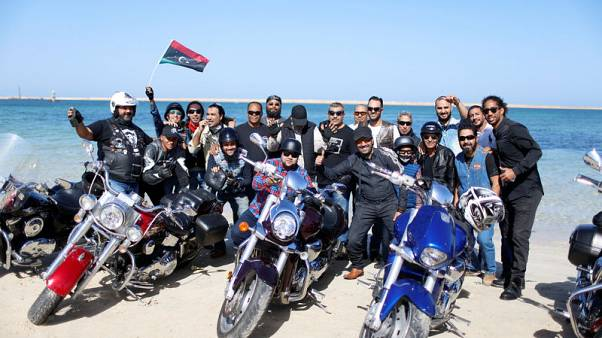 Members of the Tripoli bikers group pose for the camera at beach in Tripoli, Libya November 4, 2017. Picture taken November 4, 2017. REUTERS/Ahmed Jadallah