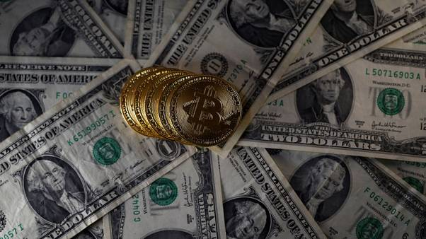 Bitcoin (virtual currency) coins placed on Dollar banknotes are seen in this illustration picture, November 6, 2017. REUTERS/Dado Ruvic/Illustration