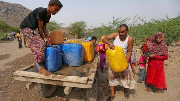 People carry jerrycans after they filled up with drinking water from a charity tanker truck in Bajil of the Red Sea province of Hodeidah, Yemen July 29, 2017. REUTERS/Abduljabbar Zeyad