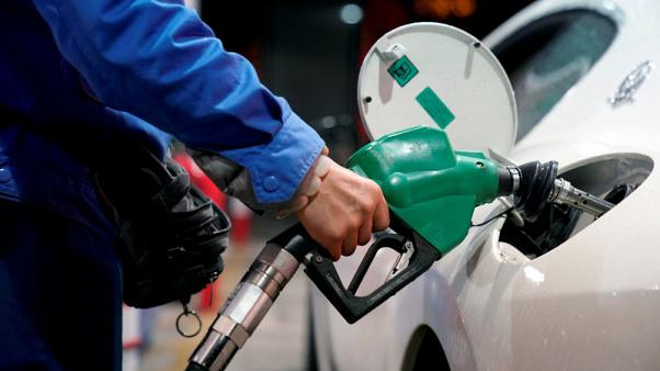 A gas station attendant pumps fuel into a customer's car at a gas station in Shanghai, China November 17, 2017. REUTERS/Aly Song