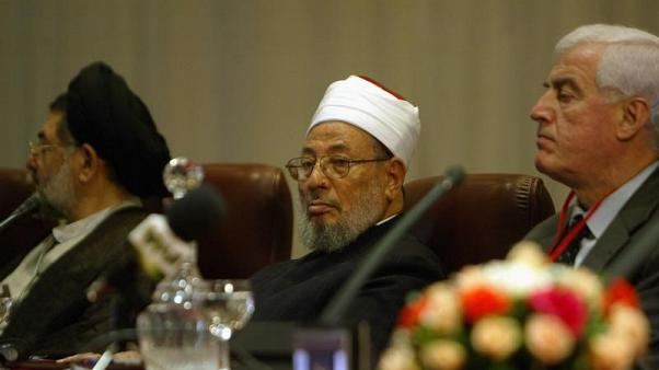Egyptian-born cleric Sheikh Youssef al-Qaradawi (C) attends the opening session of the fifth International Al-Quds conference in Algiers March 26, 2007.REUTERS/Louafi Larbi (ALGERIA)