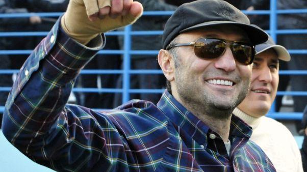 Suleiman Kerimov watches a soccer in Makhachkala December 2, 2012.  REUTERS/Sergei Rasulov/ NewsTeam