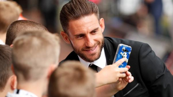 Football Soccer -  Premier League - Swansea City vs Manchester United - Swansea, Britain - August 19, 2017   Swansea City's Angel Rangel poses for a selfie with fans before the match   Action Images via Reuters/Andrew Boyers