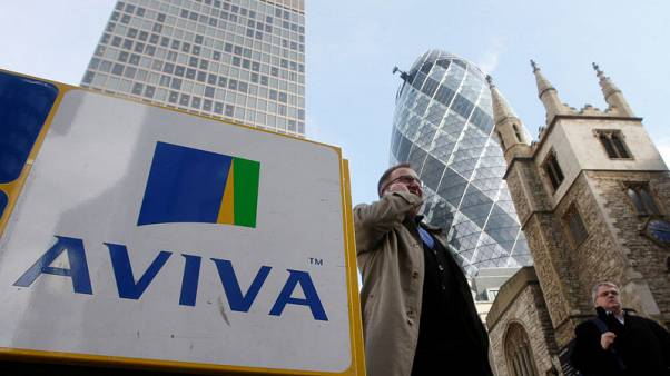 FILE PHOTO - Pedestrians walk past an Aviva logo outside the company's head office in the city of London March 5, 2009.     REUTERS/Stephen Hird/File Photo