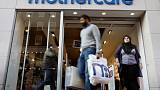 FILE PHOTO: Customers leave a Mothercare shop in London October 11, 2008.  REUTERS/Suzanne Plunkett/File Photo