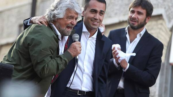 FILE PHOTO: 5-Star movement members Beppe Grillo (L), Luigi Di Maio (C) and Alessandro Di Battista attend a demonstration against the new electoral law in downtown Rome, Italy October 25, 2017. REUTERS/Tony Gentile/File Photo - RC110BF03E30