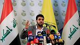 Hashim al-Mousawi, the official spokesman for Harakat Hezbollah al Nujaba, speaks during a news conference in Baghdad, Iraq November 23, 2017. REUTERS/Thaier Al-Sudani