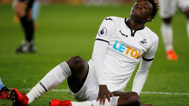 Soccer Football - Premier League - Burnley vs Swansea City - Turf Moor, Burnley, Britain - November 18, 2017  Swansea City's Tammy Abraham after sustaining an injury             Action Images via Reuters/Craig Brough