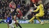FILE PHOTO: Southampton's Graziano Pelle (C) scores a goal past Everton's goalkeeper Tim Howard during their English Premier League soccer match at St Mary's Stadium in Southampton, southern England December 20, 2014.     REUTERS/Toby Melville