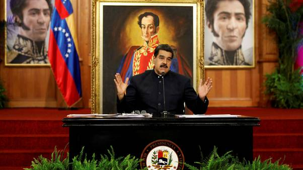 FILE PHOTO - Venezuela's President Nicolas Maduro (C) gestures as he arrives for an event with supporters at Miraflores Palace in Caracas, Venezuela November 22, 2017. Miraflores Palace/Handout via REUTERS