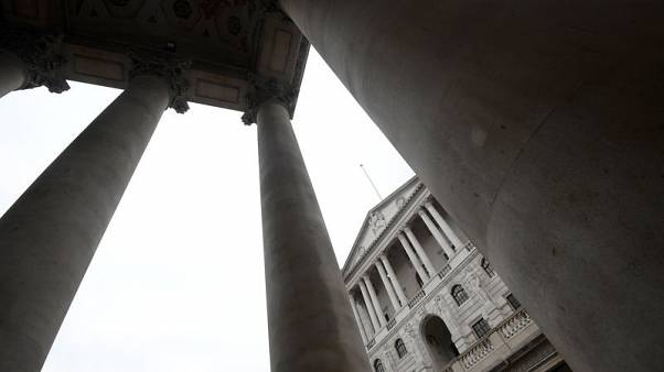 FILE PHOTO - The Bank of England is seen through the columns of the Royal Exchange in the City of London, Britain, November 2, 2017. REUTERS/Toby Melville