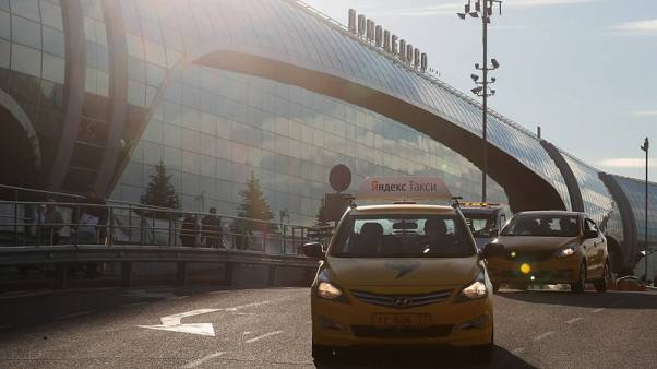 FILE PHOTO - A taxi with the logo of Russian online taxi service Yandex Taxi drives past a terminal of the Domodedovo Airport outside Moscow, Russia, November 2, 2017. REUTERS/Maxim Shemetov