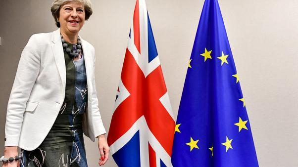 FILE PHOTO - Britain's Prime Minister Theresa May arrives for a meeting with European Council President Donald Tusk at a European Union leaders summit in Brussels, Belgium October 20, 2017. REUTERS/Geert Vanden Wijngaert/Pool/File Photo