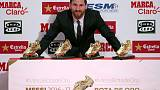 Barcelona's Lionel Messi poses with his four Golden Boot trophies during a ceremony in Barcelona, Spain, November 24, 2017.  REUTERS/Albert Gea