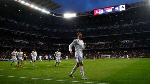 رونالدو يكسر نحسه في الدوري الإسباني ويهدي ريال الفوز على ملقة