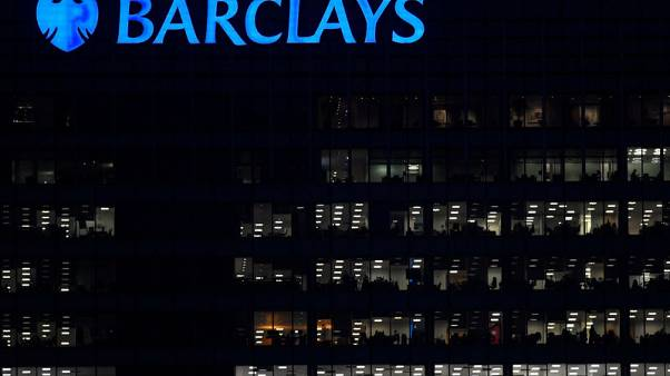 Workers are seen in at Barclays bank offices in the Canary Wharf financial district in London, Britain, November 17, 2017.   REUTERS/Toby Melville