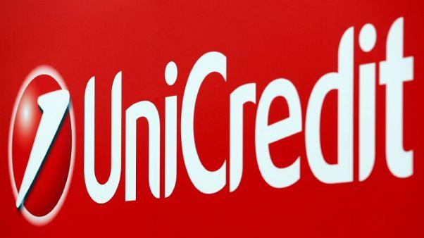 UniCredit steps up bad loan reduction, raises dividend