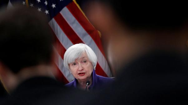Fed's rosy economic scenario leaves inflation puzzle for Powell